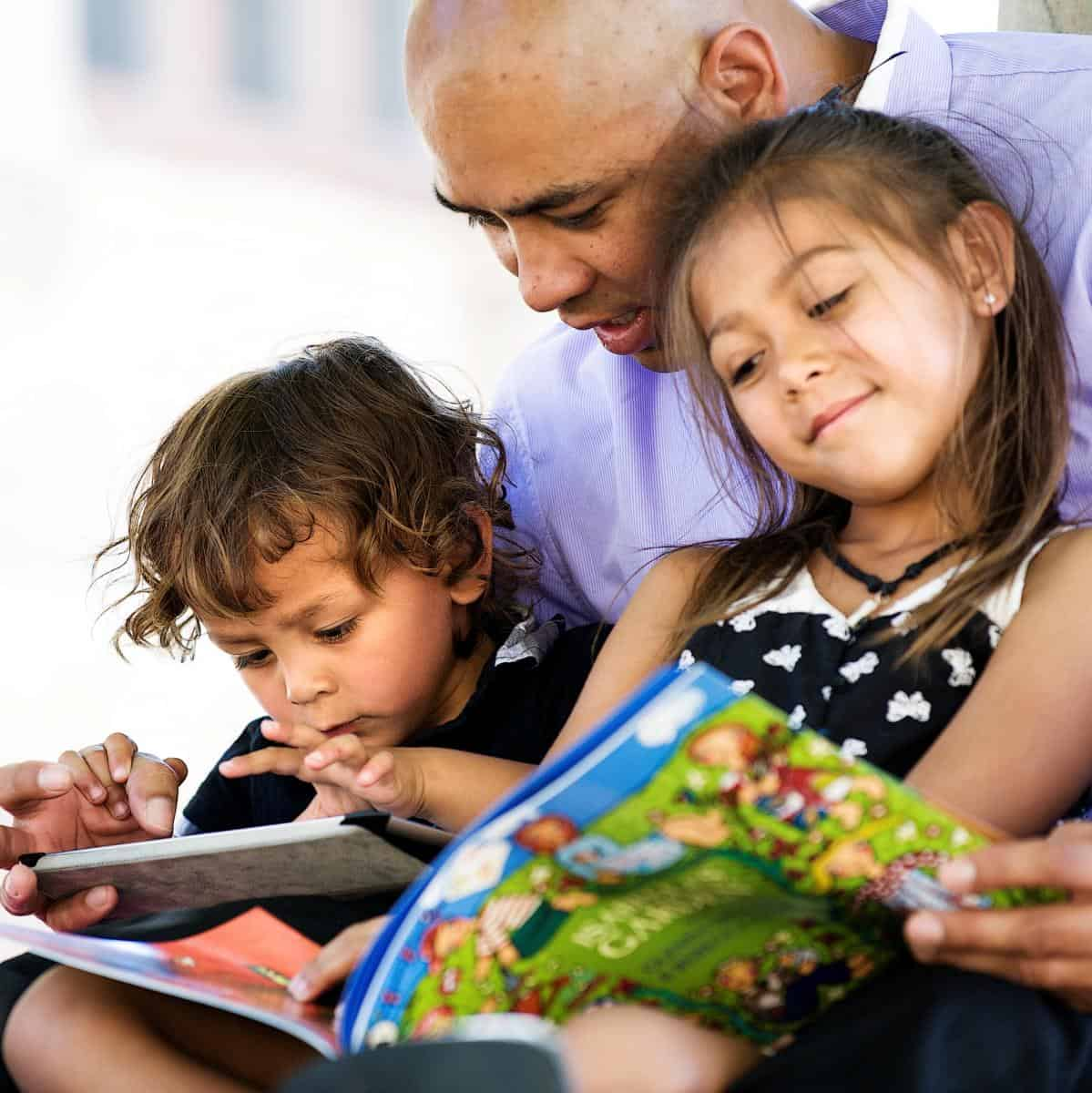 Dad and two kids reading